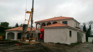 Picture of construction site of house and pool