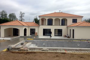Picture of the construction site of a house and pool